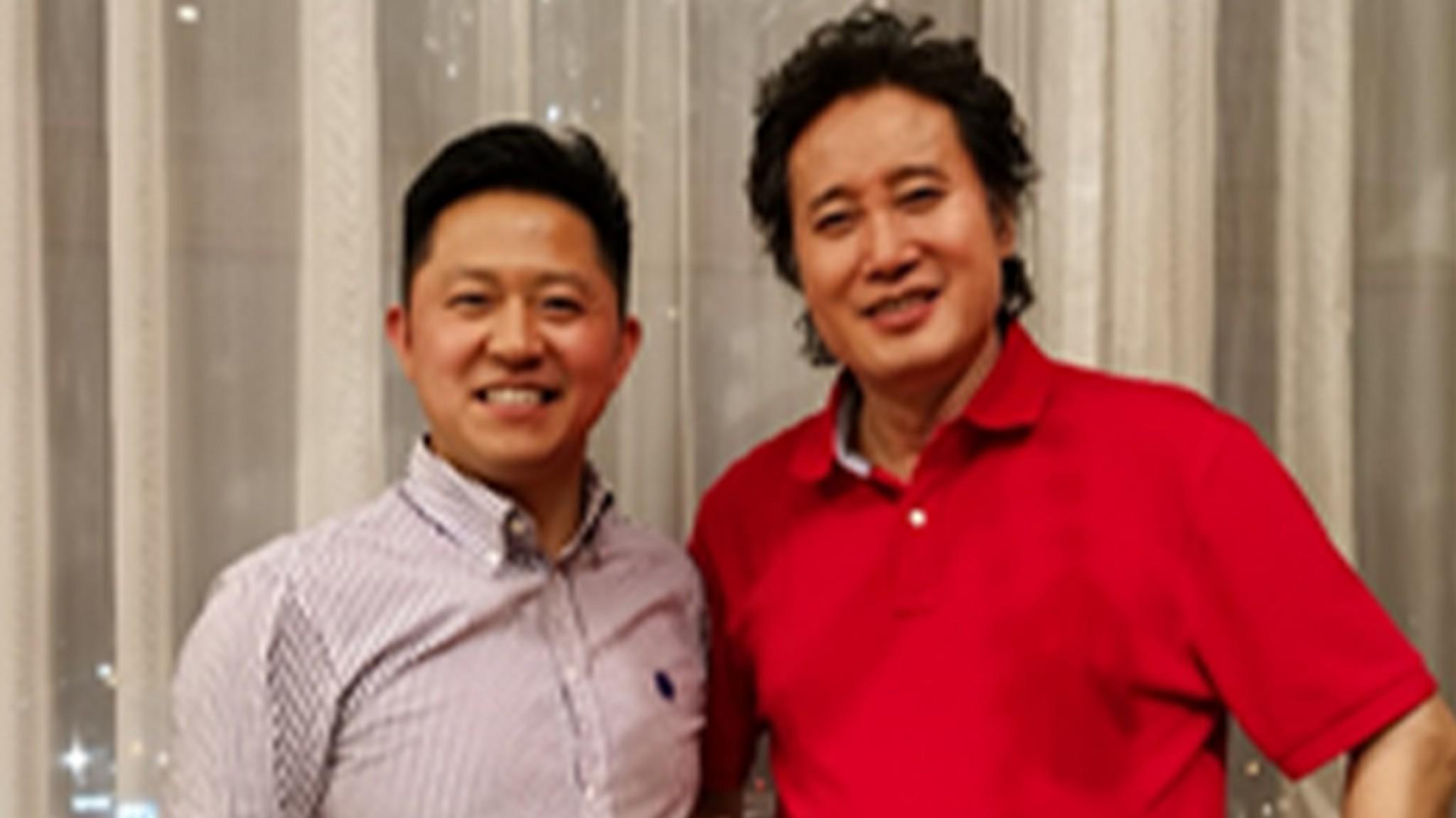 魏国锋校长与著名男高音歌唱家戴玉强